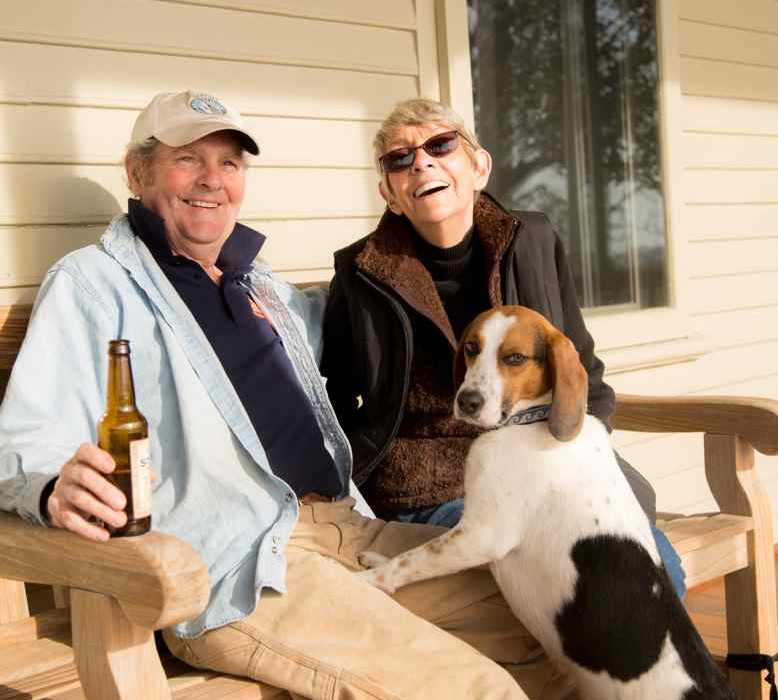 couple and dog beagle on porch newport ri party