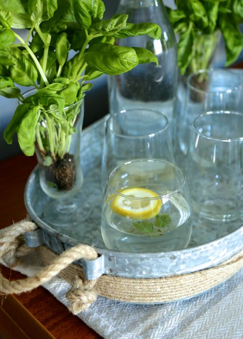 Fresh basil brightens the bar area. And a touch of mint and lemon in the water offers guests a fresh drink!