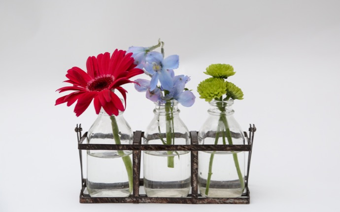 A trio of bud vases can also lend a minimal but amazing arrangement of flowers!