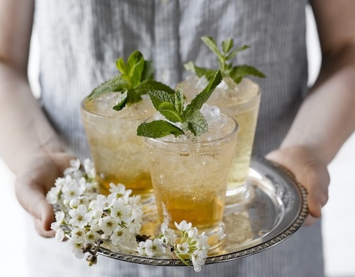 Mint juleps on silver tray with flowers