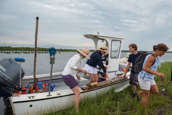 Walrus and Carpenter oyster farm to table dinner getting out of the boat